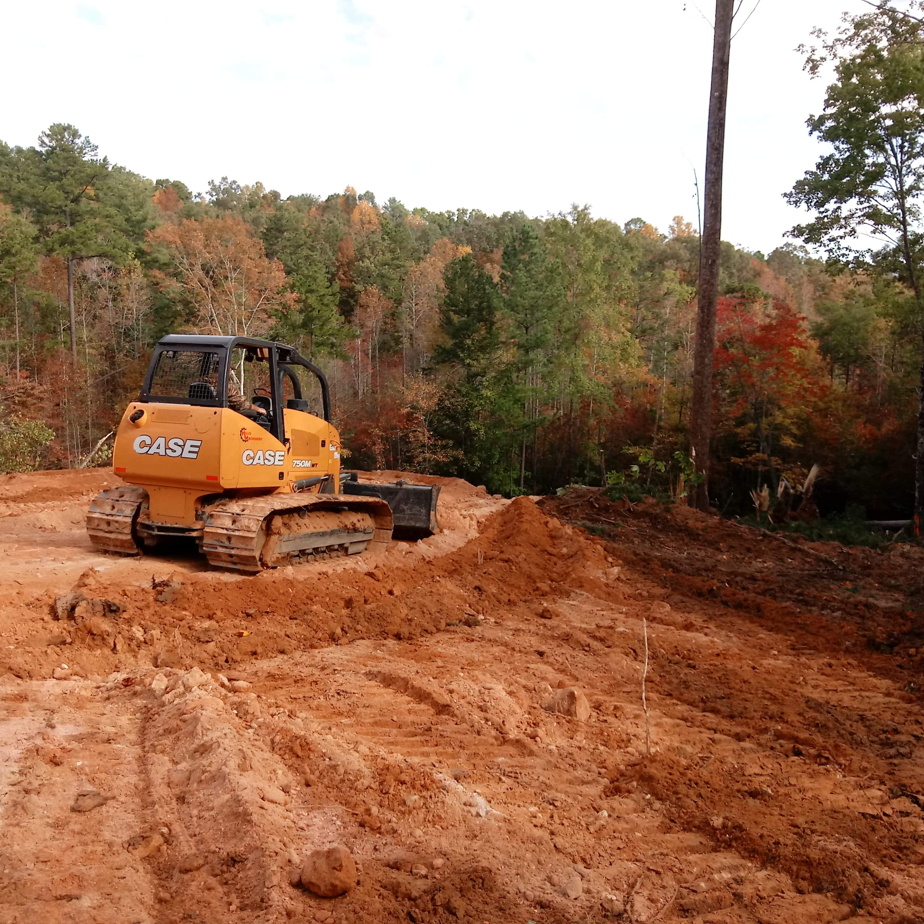 Clearing and Grading with Equipment near woods